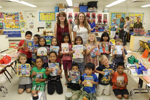 An excited class with their new Book Trust books